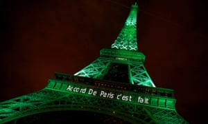 The Eiffel Tower is illuminated in green with the words 'Paris agreement is done', to celebrate the Paris climate change agreement, on 4 November 2016.