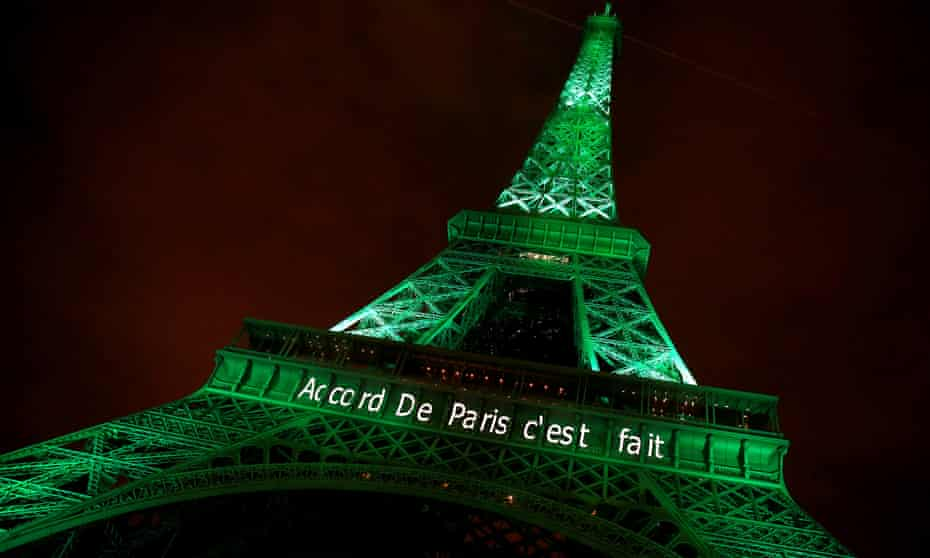 The Eiffel Tower illuminated green to celebrate the Paris climate change agreement. The arrival of the Trump administration is causing concerns that the US will fall further behind in addressing climate change.