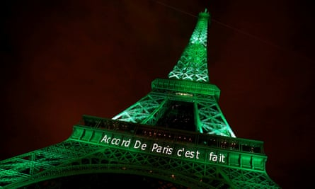"""The Eiffel tower is illuminated in green with the words """"Paris agreement is done"""", to celebrate the Paris climate agreement"""
