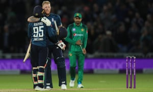England's Ben Stokes and Adil Rashid celebrate victory.