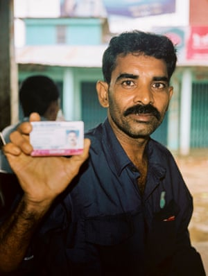 A Rohingya man in Teknaf, a town on the southern coast of Bangladesh, with his registered refugee card