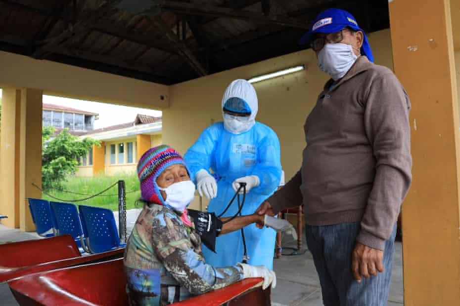 A woman receives medical assistance at Loreto Regional Hospital.