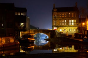 January 2021: a night view of the Leeds and Liverpool canal running through the market town of Skipton