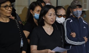 Pansy Ho, centre, announces the death of her father outside a hospital in Hong Kong
