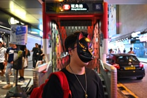 A man wears a mask as he takes part in a flash mob rally in the Mong Kok district on Saturday.