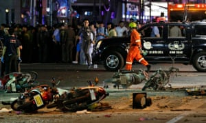 Motorcycles lie on the street at the scene of the explosion near the Erawan shrine in central Bangkok.