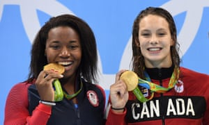 Simone Manuel, left, and Canada's Penny Oleksiak shared gold in the 100m freestyle.