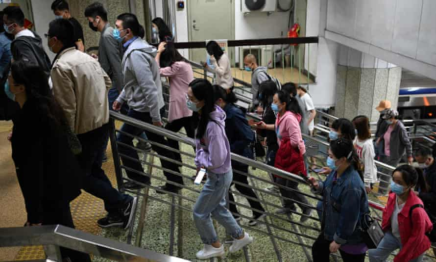 People walk in the subway as the outcome of the seventh national population census by the National Bureau of Statistics of China, are released in Beijing
