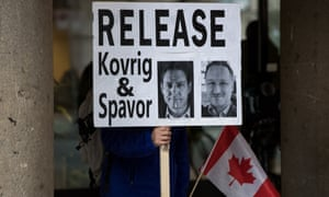 Supporters of detained Canadians Michael Kovrig and Michael Spavor at an extradition hearing for Huawei executive Meng Wanzhou in Vancouver this year