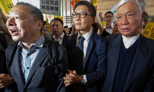 Benny Tai, Chan Kin-man and Chu Yiu-ming prepare to enter court for the verdict on Tuesday.