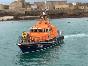 The Alderney lifeboat returns to the island for a crew change before resuming the search for the missing plane.