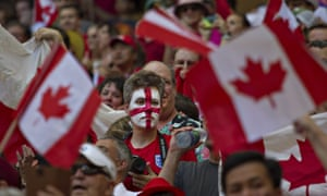 England supporter is surrounded by Canadian flags.