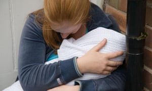 Woman with baby in doorway