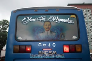 An image of Hernández adorns the back window of a bus in Caracas