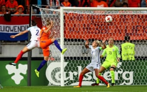 Vivianne Miedema scores the opening goal with a deft header.