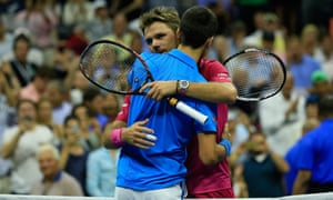 Stan Wawrinka and Novak Djokovic embrace at the end of their match at Flushing Meadows