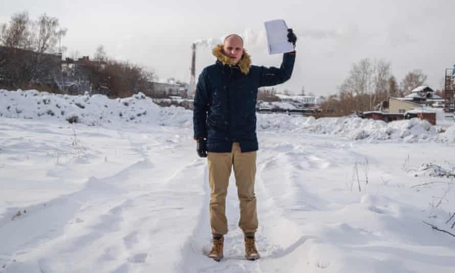 Denis Karagodin holding the KGB letter he was sent in the post