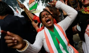 A Congress supporter. After the results, the party tweeted: 'Democracy has won!'