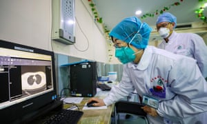 A doctor checks CT images of a patient at a hospital in Wuhan, China.