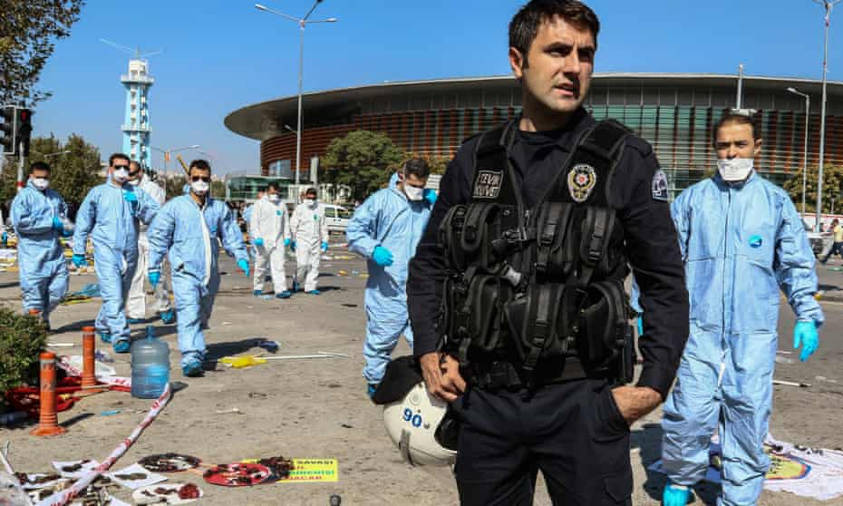 Police inspect the blast site after an explosion during a peace march in Ankara last October.