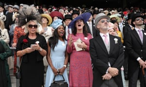 Racegoers cheer on the winer of the first race at Royal Ascot.
