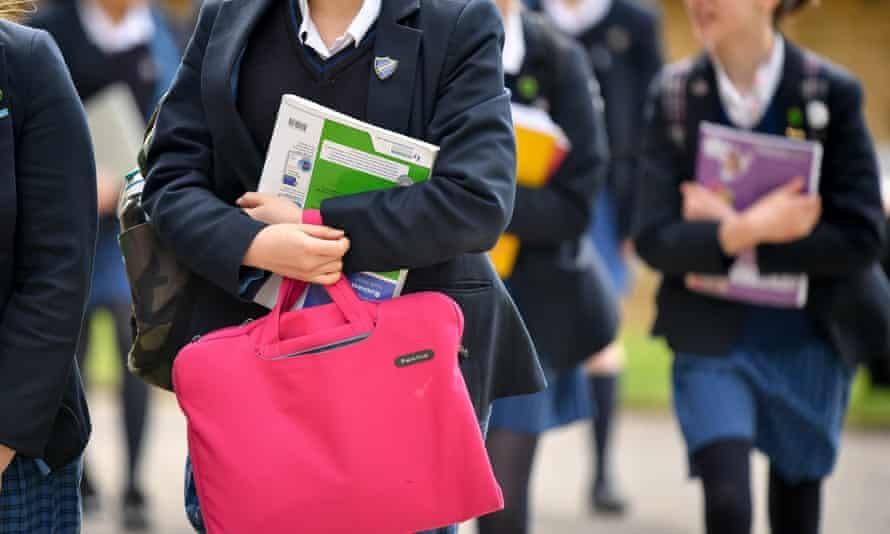 School girls in skirts