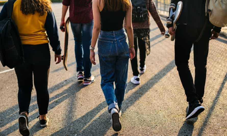 Teenagers walking away from something
