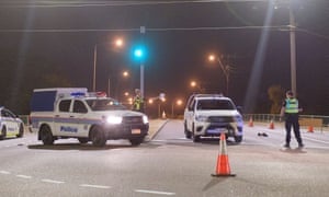 Police cordon off intersection a gunman was apprehended in Darwin, Tuesday 4 June.