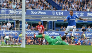 Everton's Theo Walcott scores their first goal.