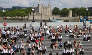 Office workers enjoy the sunshine on the Thames as the UK basks in a heatwave.