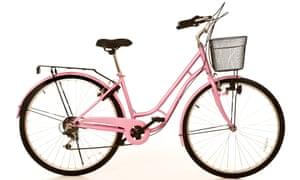Retro style ladies bike on plain white studio background