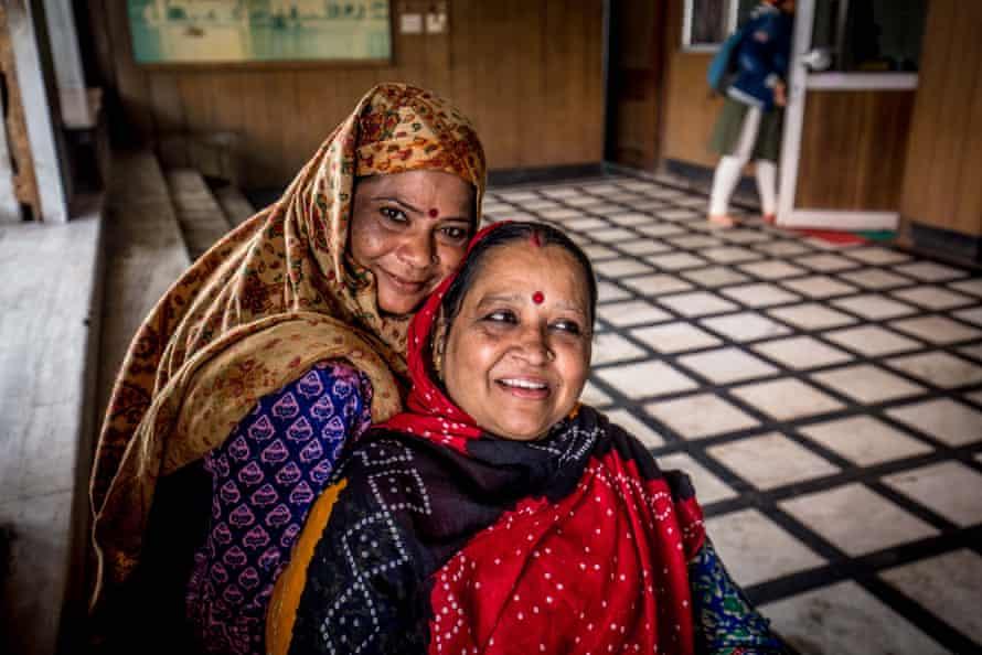 Two friends outside the Gurudwara Sis Ganj Sikh temple in Delhi