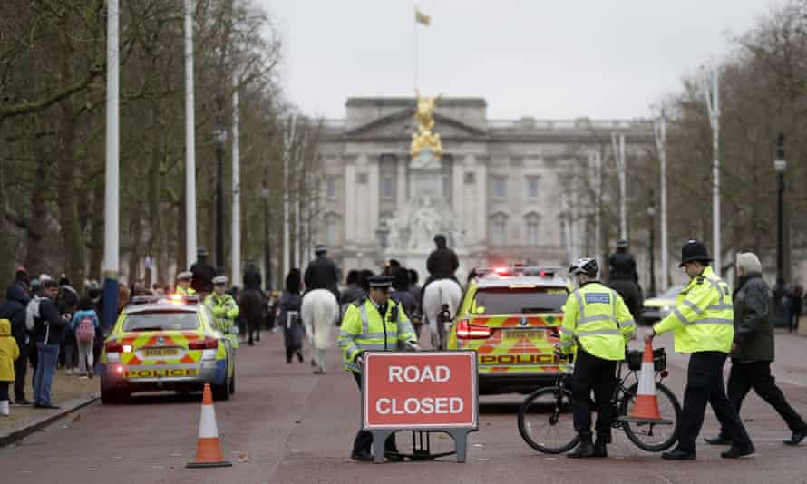 Police officers close the road leading up to Buckingham Palace for the changing of the guard.
