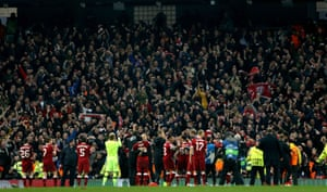 The Liverpool players celebrate in front of their fans at the Etihad.
