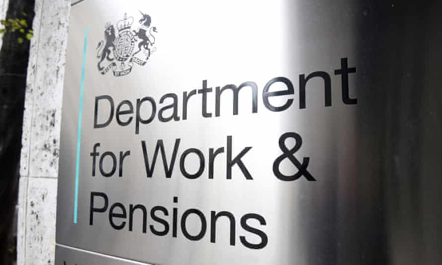 A sign is seen outside the Department for Work and Pensions in Westminster, London