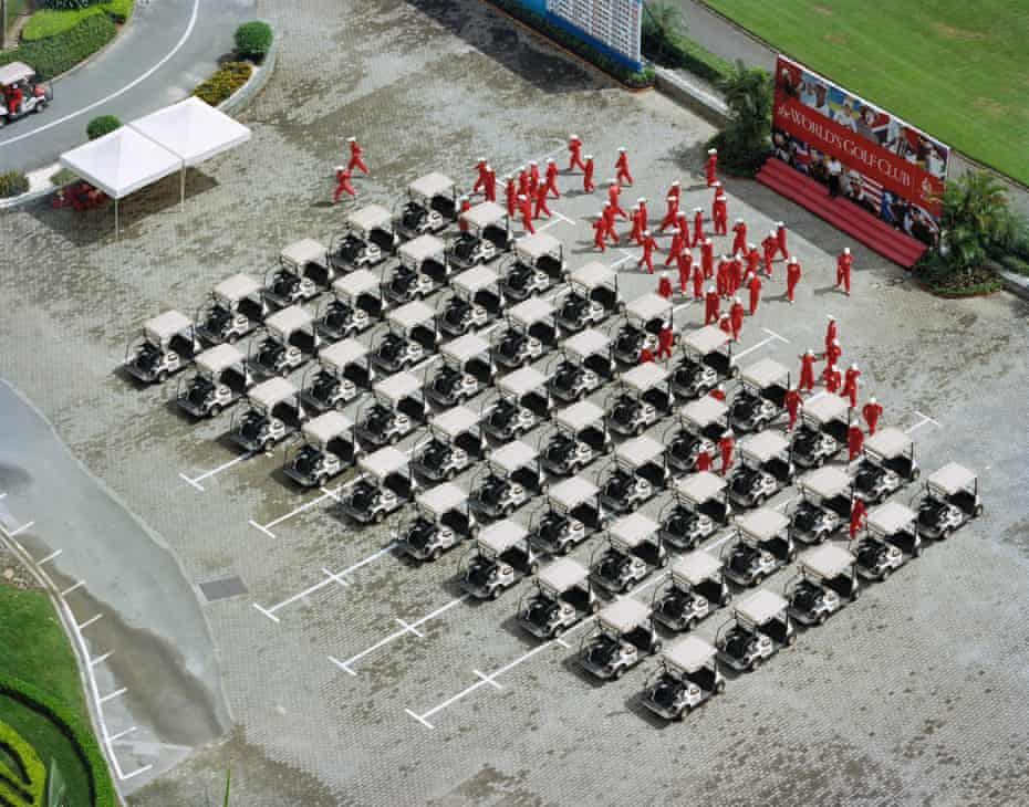 Caddies go to work at the Mission Hills golf course, Guangdong, China.