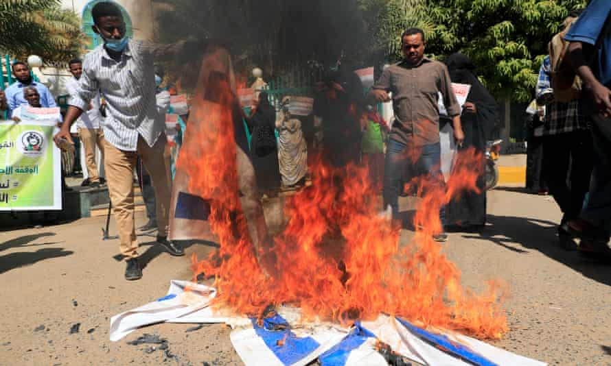 protesters with israeli flags on fire on the ground