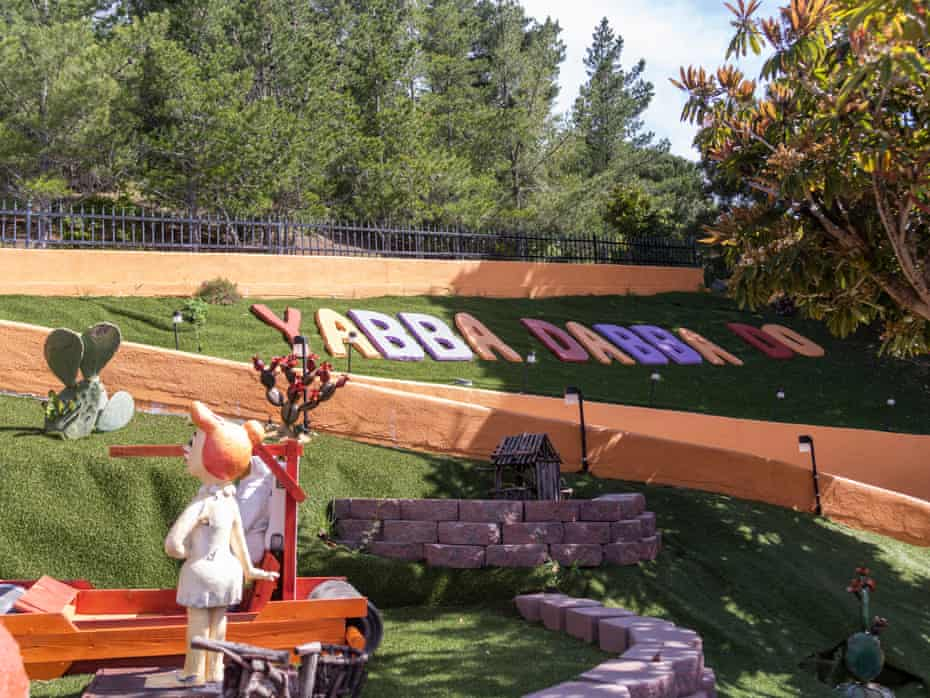 Giant letters reading 'Yabba Dabba Do' in Mrs Fang's backyard.