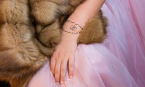 Fur enough: Elizabeth, 15, daughter of a Russian shipping magnate, dressed to appear in the Tatler Debutante Ball in Moscow, with a temporary Chanel tattoo.