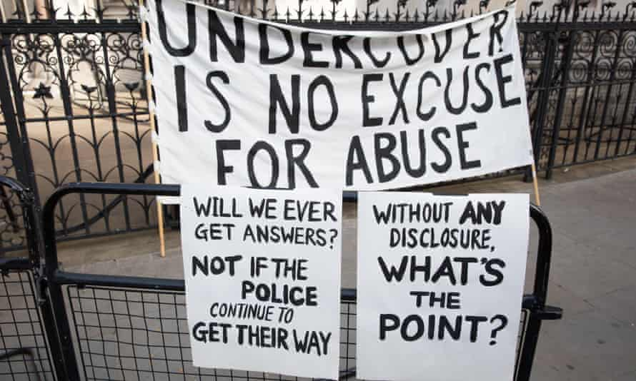 Banners protesting against undercover police outside the Royal Courts of Justice
