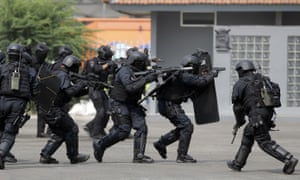 Indonesian police and military special forces take part in an anti-terrorism drill ahead of the 2018 Asian Games in Jakarta, Indonesia