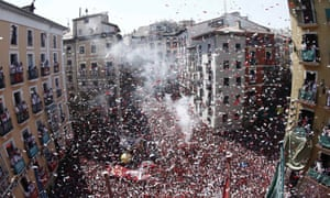 Revellers attend the firing of the 'chupinazo' that marks the beginning of the Festival of San Fermin