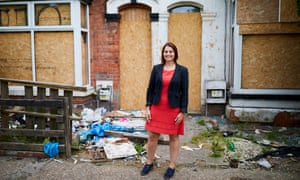 Shadow housing minister Melanie Onn in front of boarded-up properties in her constituency of Great Grimsby.