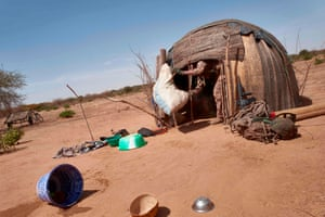 A French army soldier searches a hut for materials that can be used to make explosives in northern Burkina Faso.