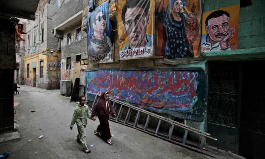 Banners depicting, among others, former Egyptian president Gamal Abdel Nasser and diva Umm Kulthum in Cairo, 2012