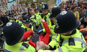 Police make an arrest at an Extinction Rebellion protest in London