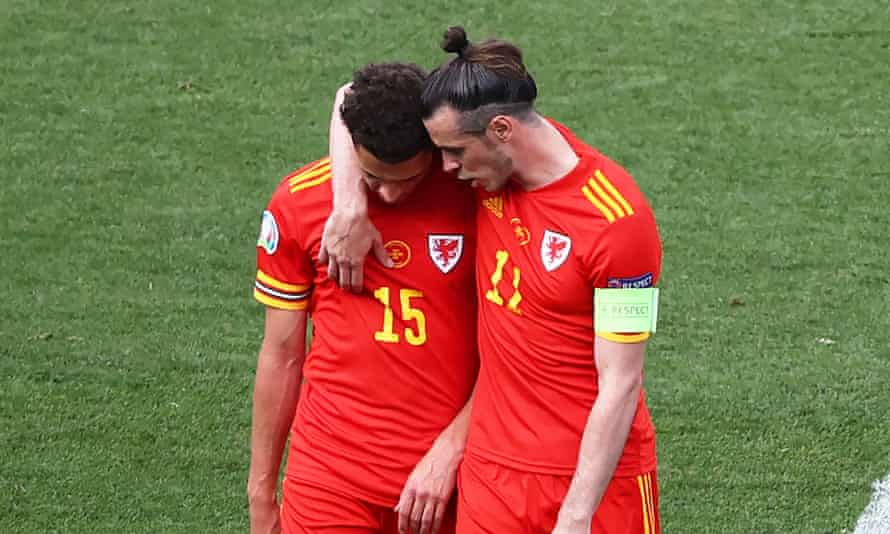 Gareth Bale consoles Ethan Ampadu after the defender was sent off in the second half.