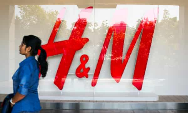 A passerby outside the first H&M to open in India, in New Delhi.