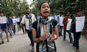 Students shout slogans during a protest against sexual violence in Kolkata