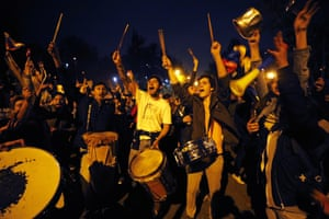 Protesters shout slogans during a demonstration in front of the private residence of Colombian president Iván Duque